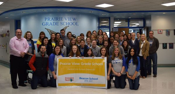 PV Staff with Beacon Award Sign