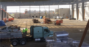 Interior of field house construction with truck