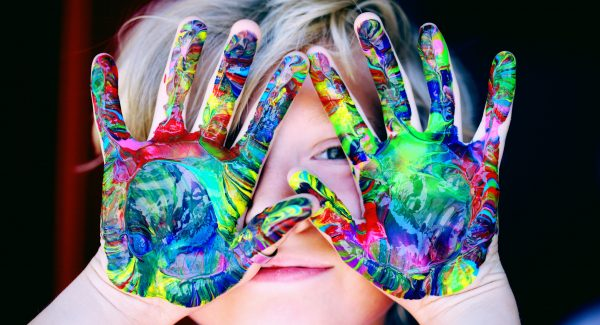 Kid with paint on hands